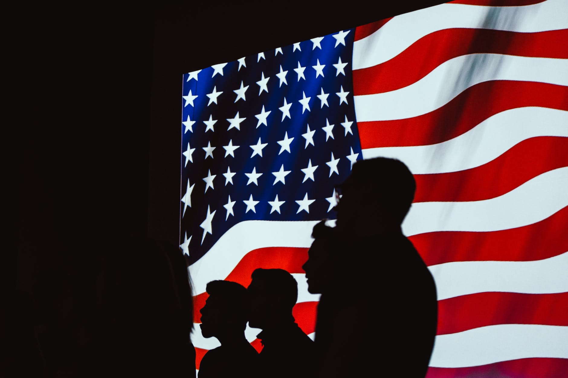 silhouette of people beside usa flag (in transition to a post military life)
